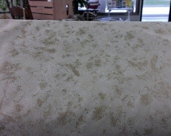 Timeless Treasure CM4117 cream background with gold metallic accents