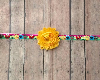 Sesame street character elastic headband featuring Elmo, cookie monster, big bird and Oscar for baby, toddler and adult
