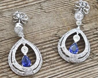 Platinum, Sapphire, and Diamond pieced post dangle earrings