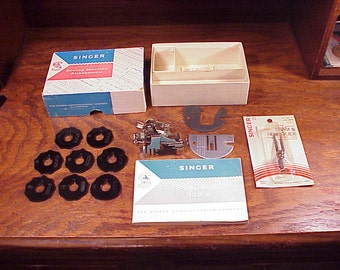 Box of some Singer 328K Sewing Machine Attachments, with Instruction Manual, 8 discs, cams, plus Seam and Hem Guide