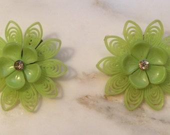 Vintage lime green soft plastic flower earrings with center rhinestone