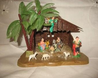 Christmas Nativity made hard plastic crib has Hong Kong 1950/60