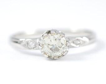 Vintage 0.55 carat Old European cut diamond, platinum engagement ring. Circa 1950.