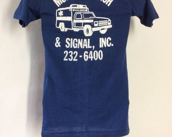 Vtg 80s Monroe Coach & Signal Inc T-Shirt Blue XS/S Stedman 50/50 Ambulance Car Truck