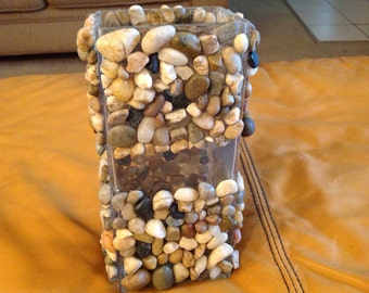 Glass and pebble candle holder