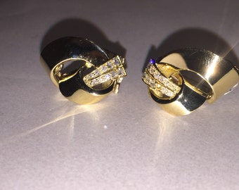 18K yellow gold and diamond ribbon clips. England circa 1960's.