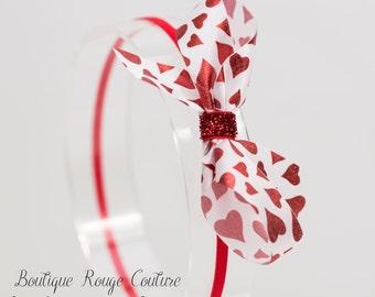 Metallic red hearts, skinny red headband.