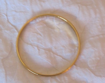 Monet 7 inch bangle bracelet, gold tone, signed Monet