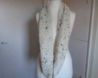 Hand crocheted winter white flecked infinity scarf in a 100 percent acrylic yarn
