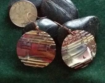 Music to my ears!                            Copper metal earrings