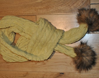 Winter scarfAutum yellow woolen scarf with two authentic raccoon fum pm poms.Long and comfy.