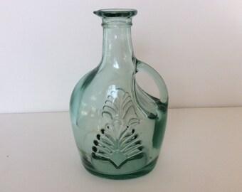 Green glass wine carafe. Green glass wine decanter. Green glass. Green glass wine decanter. Green glass wine carafe with 10 oz capacity.
