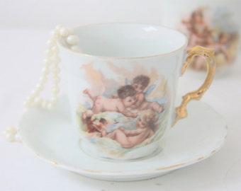 Rare Antique Brussels Porcelain Cup and Saucer, Cherub Decor,  Handpainted