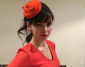 Orange tiny wool felt pillbox hat with feather races wedding