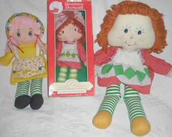 Three Strawberry Shortcake Dolls