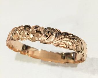 14 karat Rose gold, 10mm Hawaiian barrel bracelet.