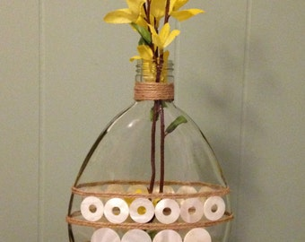 Coastal style clear glass bottle/case with mother of pearl and jute trim.