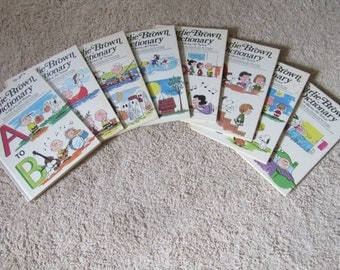 The Charlie Brown Dictionary (8 Volume Set) Hardcover – 1973 by Charles M. Schulz