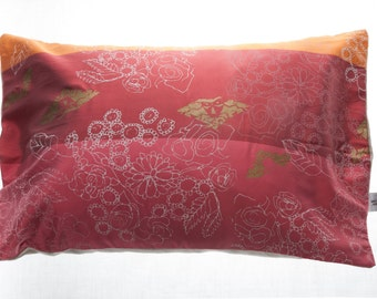 Red, orange and pink floral silk and hemp cushion cover.