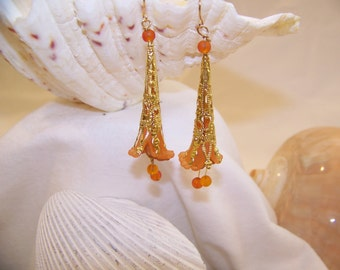 Handcrafted tangerine color Sea Glass and Lucite trumpet Calla Lily flower bead dangle earrings.