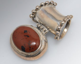 Southwestern Sterling Silver Pendant with Polished Brown Stone