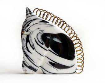 Streamlined horse head design made of black and white swirly poly resin