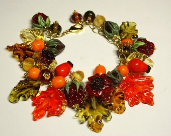 Handmade lampwork bracelet with glass berries, flowers, nuts and leaves in golden autumn colors, glass bracelet, beaded bracelet