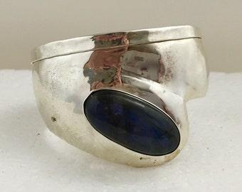 Sterling silver cuff with oval labradorite stone.