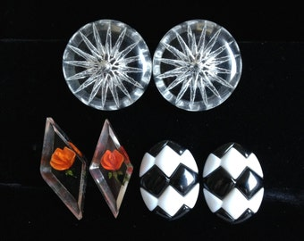 Retro 80s plastic Checkerboard earrings, vintage reversed carved lucite screw back earrings, and Vintage starburst carved