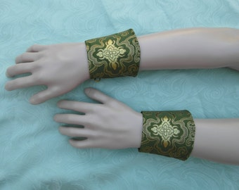 Pair of green and gold brocade wristbands