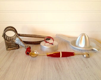 Multiple classic red kitchen utensils