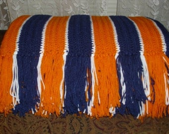 Blue and orange striped afghan with fringe. Broncos / Bears / Tigers themed afghan. Blue and orange striped afghan with fringe on two sides.
