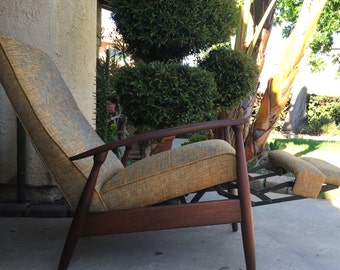 ON HOLD*** A 1960s Mid Century vintage recliner chair. In the style of Milo Baugham