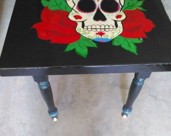 Small, black hand painted end table. This is a unique one of a kind hand crafted table.