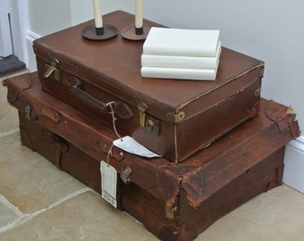 Pair of beautiful vintage suitcases with original travel labels