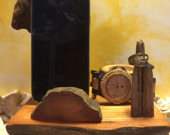 Docking station for any cell phone.  Handmade from driftwood and reclaimed wood.