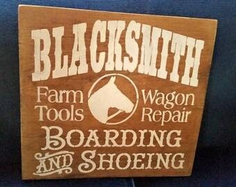 Blacksmith, Farm tools, Boarding, wagon Repair, shoeing, livery sign