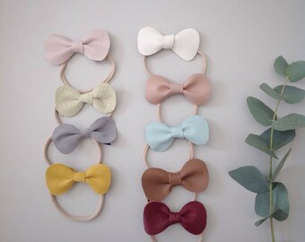 Cute headband with leather bow!