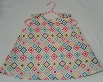 Girls multi colored swing top.