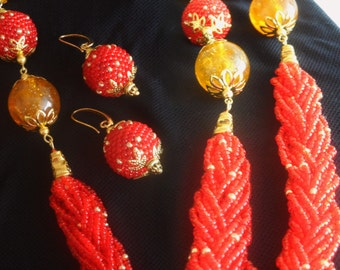 Red plait. Set necklace with earrings.