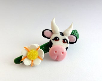 Cow country child Balasubramanian & flower cold porcelain