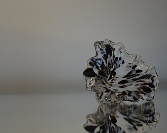 Hand blown clear glass flower with black and white streaks