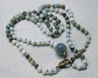 Hand knotted necklace with gemstones