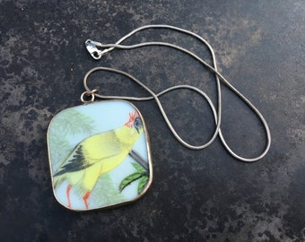 Charming porcelain shard pendant. Semi cubist rooster!