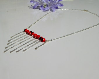 Pendant silver necklace with red and black huayruro seed beads