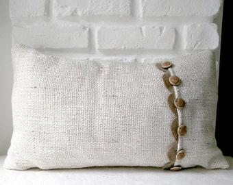 Hand-sewn cushion in fabric to frame