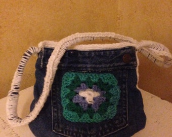 Jean purse with crochet backing.