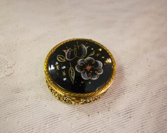 Floral black enamel mirrored round compact, with gold mesh bottom