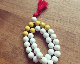 Saffron green rosary and Red Pompom
