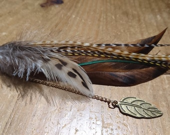 Single long natural feather earring with leaf pendant